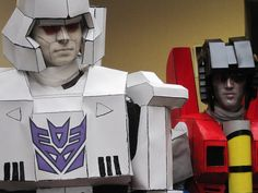 Megatron cosplay built from monkeyrum's model and debuted at Kitsune Kon 2011 It was made of printed cardstock paper, held together with regular elmer's glue, and backed with great stuff foam. It d...
