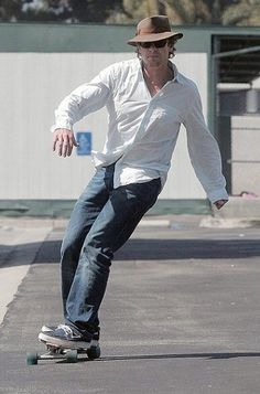 Simon Baker with his toy. Gosh I love him.
