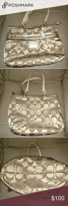 Coach Poppy Daisy Signature Handbag Gold Khaki Coach signature fabric tote with patent leather trim & double straps in good, used condition. It has 2 hang tags (larger clear glitter Coach & patent leather Coach rectangle), front zip pocket w/ heart shaped pull ring, top zip closure, large interior zip pocket, 2 multi-function slip pockets, and sateen fabric lining. There is a small spot on the back (see pic #2) which may be able to be cleaned, and there are a few small ink pen lines inside…