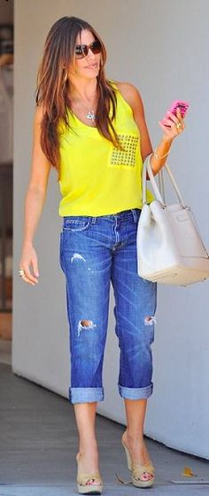 Who made Sofía Vergara's jeans and nude handbag that she wore in West Hollywood?