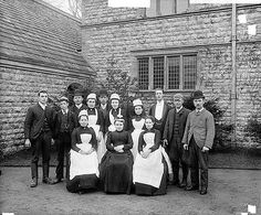 The servants of Glencot in a posed photograph outside the north-east elevation of the house. The photograph was taken for W S Hodgkinson, the owner of the house. Victorian Aprons, Victorian Maid, Victorian Life, Old Photos, Vintage Photos, Antique Photos, Acacia, The Real Downton Abbey, St Cuthbert