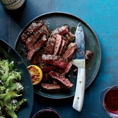 Grilled Skirt Steak with Shishitos and Charred Lemon | Food & Wine