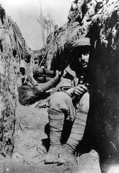 French soldiers protect themselves from shrapnel in a dugout. 1st August 1914.