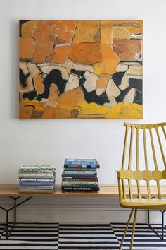 Living Room - A bench topped with stacks of books beside a yellow chair - wall art Interior Inspiration, Design Inspiration, Design Ideas, Living Room Photos, Mellow Yellow, Blue Yellow, Decoration, Photo Wall Art, Gallery Wall