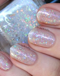 Femme Fatale - Iridial | Hella Holo Customs January 2016 | January 14, 2016 | inspired by a stunning rainbow opal image suggested by Stephanie E, and named by Ana M.  A milky blue-tinted white base filled with an iridescent array of FOUR different types of crystalline colour-shifting flakes, red & blue shimmers, and a selection of silver holographic microglitters/ Milky storm-grey base filled with silver holo microglitters in various sizes, green/red/gold crystalline flakes (that have…