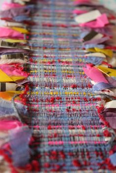 Weave with fabric strips.