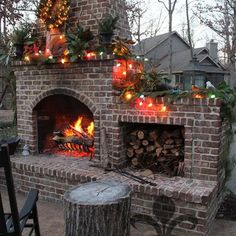 Outdoor fireplace dress up in it's holiday decor #outdoorholidaydecorations
