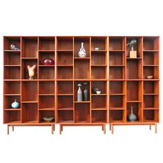 Impressive set of six teak bookcases designed by Peter Hvidt. Each with exposed finger joints and adjustable shelves.