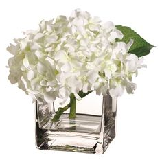 My kitchen table centerpiece: fake white hydrangea in a square glass vase, filled with yellow marbles