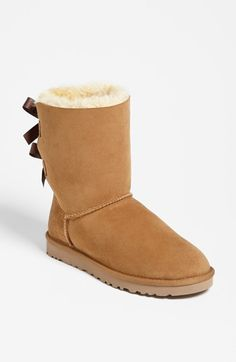 Free shipping and returns on UGG® Australia 'Bailey Bow' Boot (Women) at Nordstrom.com. Tonal bows pretty up an iconic boot.The soft, cozy lining is made from genuine shearling with a plush UGGpure™ footbed to keep feet warm and comfortable. UGGpure™ is a moisture-wicking textile made entirely from wool but crafted to feel and wear like genuine shearling. #uggs #boots