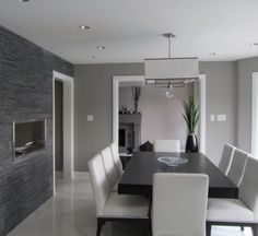 Stone harbor - BM - White square pendant chandelier.  Black table, white chairs, charcoal accent wall.
