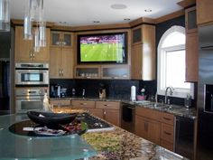 Large built-in TV in kitchen | Yelp