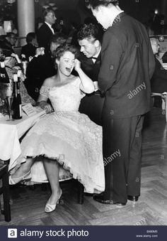 Download this stock image: Schneider, Romy, 23.9.1938 - 29.5.1982, German actress, full length, sitting, with Claus Biederstaed and Frank Holmes, Berlin Fi - B480M5 from Alamy's library of millions of high resolution stock photos, illustrations and vectors.