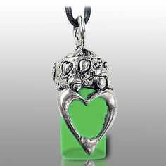 The Family Heart Pet Keepsake Pendants are made from beautiful palm green glass with an elegant design on the top. The pet keepsake pendant is made to be filled with cremation ashes but could be used for any other small memory item as well. With these pet keepsakes you can create more than just a beautiful memorial for your beloved pet. This pendant can become a cherished heirloom for your family.