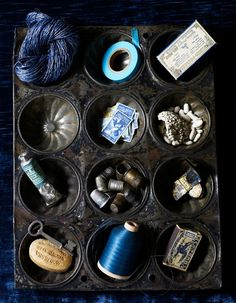 great way to display trinkets and luck charms (i have dozens) Id antique the muffin tray or spray paint it and attach my trinkets and hand it like a shadow box =)