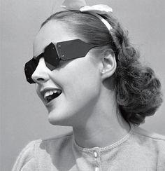 Woman in celluloid sunglasses, circa 1930s.