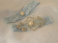 Stretch Lace Wedding Garter Set With Pearl And Rhinestone applique Centering. $29.95, via Etsy.