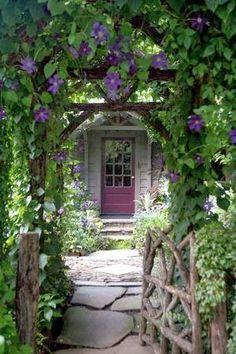 Charming rustic arbor & gate entrance to home of landscape designer David Ellis