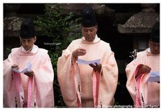 A Shinto ceremony with men dressed in kariginu.