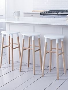 Carefully handcrafted from sustainable and responsible raw oak, our contemporary round topped stool features visible wood grain details making each stool completely unique. Each has a soft white top to compliment the natural wood. Suitable for seating around a breakfast bar or as a standalone seat, this stylish stool features gently angled rounded legs and four decorative rungs. Also available in natural.: