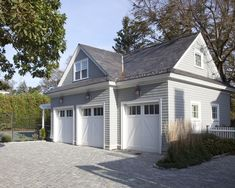 Garaggood driveway alternative to concrete...nice shape of garage. like the low fence and the landscaping