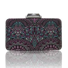 This classic Empire Espey is covered in brocade inspired by Art Deco architecture and reminiscent of the New York landmark. Featuring a Brass box casing, with a faceted clasp, KOTUR's signature brocade lining and a 30 cm drop-in shoulder chain. This compact minaudiere will fit evening essentials and  an iPhone 6+ .
