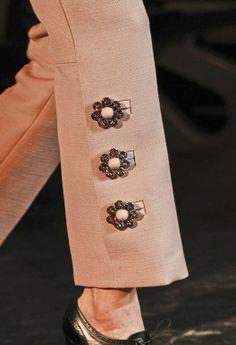 Custom #button embellished pant legs at Louis #Vuitton via Vogue