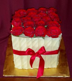 single square double high tower cake for 40 dessert pieces with fresh red roses  www.elisabethscakes.com.au