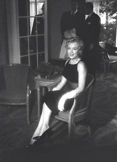 Marilyn at a press conference for The Prince and the Showgirl, 1956.