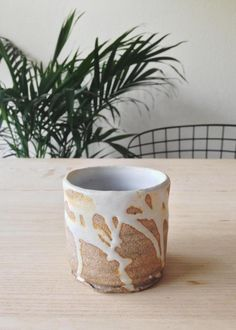 ceramic cup w/ dripping glaze
