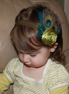 Baby Toddler Girls Boutique Green Flower with Peacock Feathers and Rhinestone accent on Elastic Headband Photo Prop. $16.99, via Etsy.