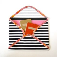 A tutorial for creating a chic little fabric envelope for carrying important papers and documents.