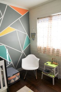 I love this geometric accent wall, but other than that this nursery is a little too busy for me. Archer's Colorful Nursery with Geometric Elements