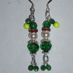 Handmade Swarovski Crystal Christmas Elf earrings. Made with Green round beads, white and yellow pearls, and red rondelles, they have little danging legs and sterling silver earwires. http://www.judesjewels.co.uk/ourshop/prod_3595250-Christmas-Elf-Earrings-Swarovski-Crystal-Sterling-Sparkly.html