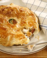 Replacing the usual puff pastry or piecrust with delicate sheets of phyllo plays up the delicious filling underneath in this lightened up chicken pot pie. A sprinkle of lively tarragon, a handful of aromatic parsley, and sauteed garlic and shallots give depth to this wintertime favorite.