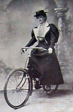 1897_Lady_Norreys_bicycle, larges sleeces a-line skirt and flat top hat