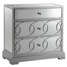 The Emporia storage chest features a modern look that will fit in any room. The mirrored surface is embellished with geometric circles that help define this outstanding piece, finished in silvertone for a look that easily integrates into any space.