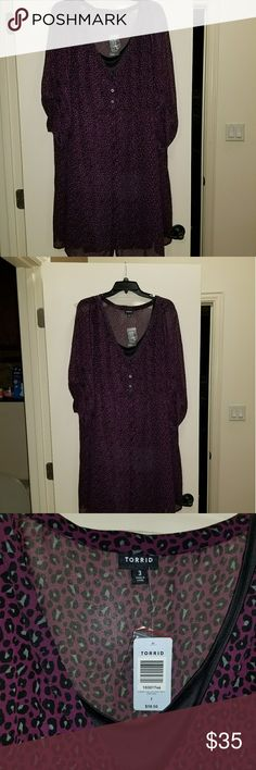 Torrid size 3 purple animal print dress NWT NWT purple and black cute torrid dress. It's 40 inches long torrid Dresses Mini