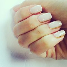 gold glitter lined manicure.