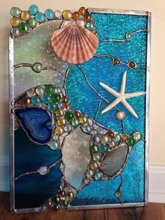 x stained glass panel featuring real starfish, sea shell and Brazilian Agates. Each piece was hand-cut, ground to fit, wrapped in copper-foil and then soldered. Finally the piece was cleaned and polished. Stained Glass Lamps, Stained Glass Panels, Sea Glass Art, Stained Glass Projects, Stained Glass Patterns, Glass Vase, Mosaic Art, Mosaic Glass, Window Art