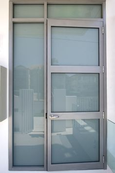 Aluminium entrance door to unit block - completed by the team at Central Glass and Aluminium 2013 - glazed in white translucent laminate