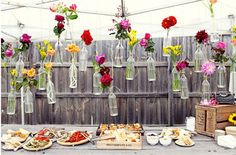 hanging flowers in clear bottles for DIY wedding & events