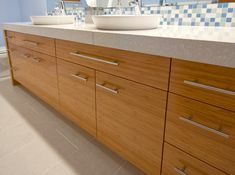Modern bathroom vanity done with bamboo and top mount sinks.  www.wholesalecabinetcenter.com