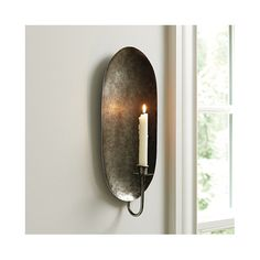 The slender, leaf-shaped silhouette of our Montenegro Candle Sconce creates a graceful frame for your taper. Made of hand hammered iron and finished in polished aged pewter. Montenegro Candle Sconce features:Swan neck armHolds a standard taper Rustic Wall Sconces, Candle Wall Sconces, Wall Candle Holders, Montenegro, Bedroom Candles, Rustic Wedding Centerpieces, Baskets On Wall, Ballard Designs, Ceiling Fixtures