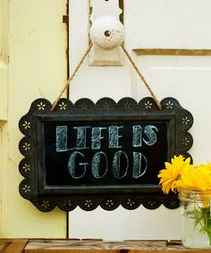 Hang this charming chalkboard anywhere in the home to leave meaningful messages for family or quirky quips for guests! The distressed tin finish and quaint scalloped edge detailing bring antique-inspired appeal to any room. 12'' W x 7'' HTin / chalkboardImported