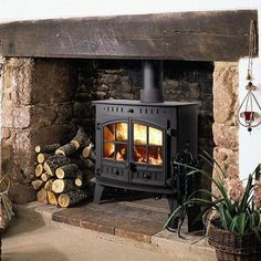 Woodburning stove and fireplace insert provide a cozy fireplace corner - Home Decoration Wood Stove Surround, Wood Stove Hearth, Wood Burner Fireplace, Inglenook Fireplace, Home Fireplace, Corner Wood Stove, Brick Fireplace, Hunter Stoves, Boiler Stoves