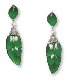 CARVED JADEITE AND DIAMOND EAR PENDANTS mounted in 18k white and rose gold. (Christie's)