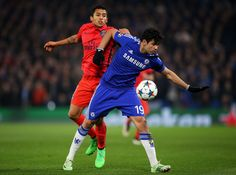 Diego Costa of Chelsea is challenged by Marquinhos of PSG during the UEFA Champions League Round of 16, second leg match between Chelsea and Paris Saint-Germain at Stamford Bridge on March 11, 2015 in London, England.