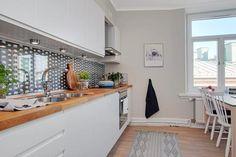 Revestimiento de tela y cristal en una cocina   detalles inesperados