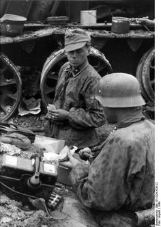 German rear lines, 1944. *Note the field telephone.